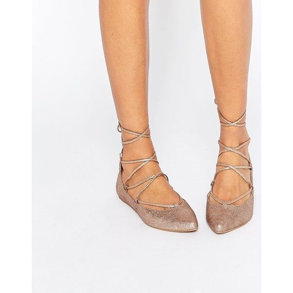 Steve Madden Eleanorr Rose Gold Wrap Ballerina Flat Shoes ($112) ❤ liked on Polyvore featuring shoes, flats, gold, ballet pumps, pointy-toe flats, pointed-toe flats, lace up flats and lace up ballet flats