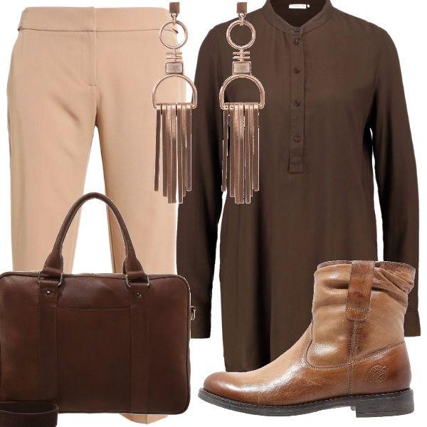 Un richiamo ai colori autunnali per i pantaloni beige indossati sotto una tunica color marrone. Nuance cognac per gli stivaletti bassi e per la borsa porta pc. Una cascata di fili luminosi per gli orecchini: per una giornata al lavoro, comodità, ma senza rinunciare all'eleganza.