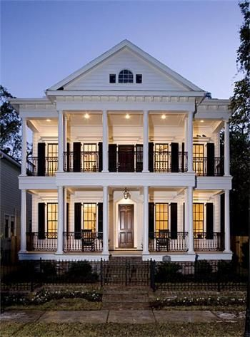 Can I tell you how much I love white houses with black shutters?? And I love big front porches so double front porches are even more awesome.