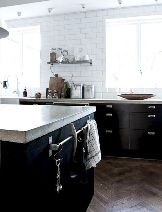 cement countertops, herringbone floors, black cabinetry, no uppers