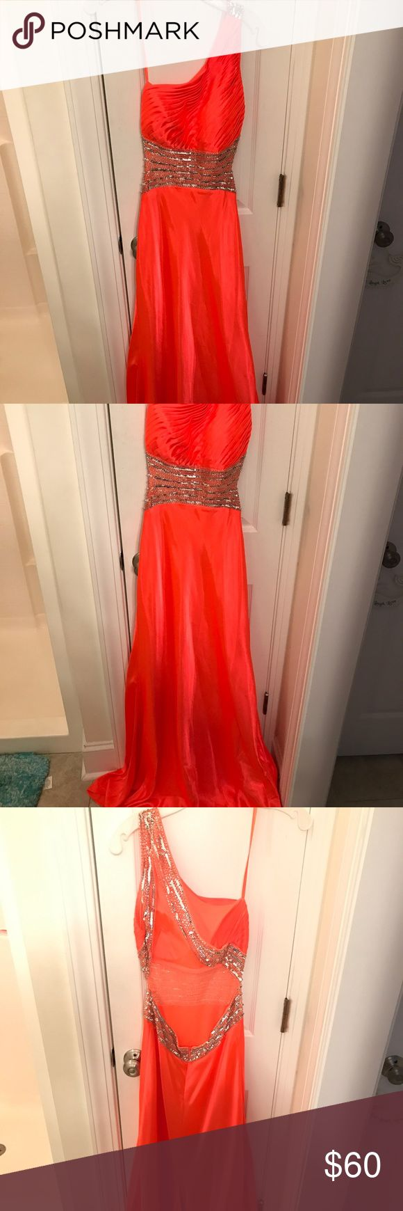 Beautiful long formal dress pink/orange size 6 Beautiful long formal dress size 6 hot pink/orange color silver sparkles around waist and across back strap, open back with strap, one shoulder strap dress flowy and comfortable no stains worn once Betsy & Adam Dresses One Shoulder