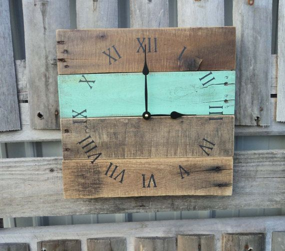 This primitive style clock is made from reclaimed pallet wood. One board is painted in a pretty sea foam green, and the others are left with the
