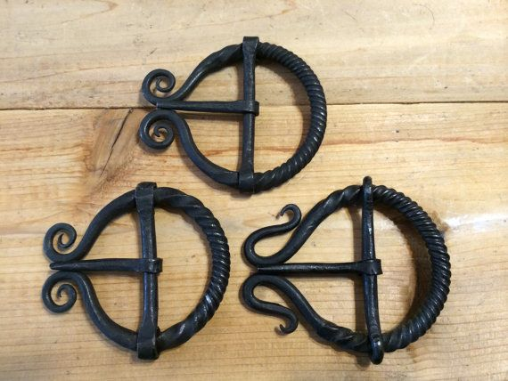 These belt buckles are completely hand forged in a coal forge using a hammer and anvil, using the same techniques that would have made the