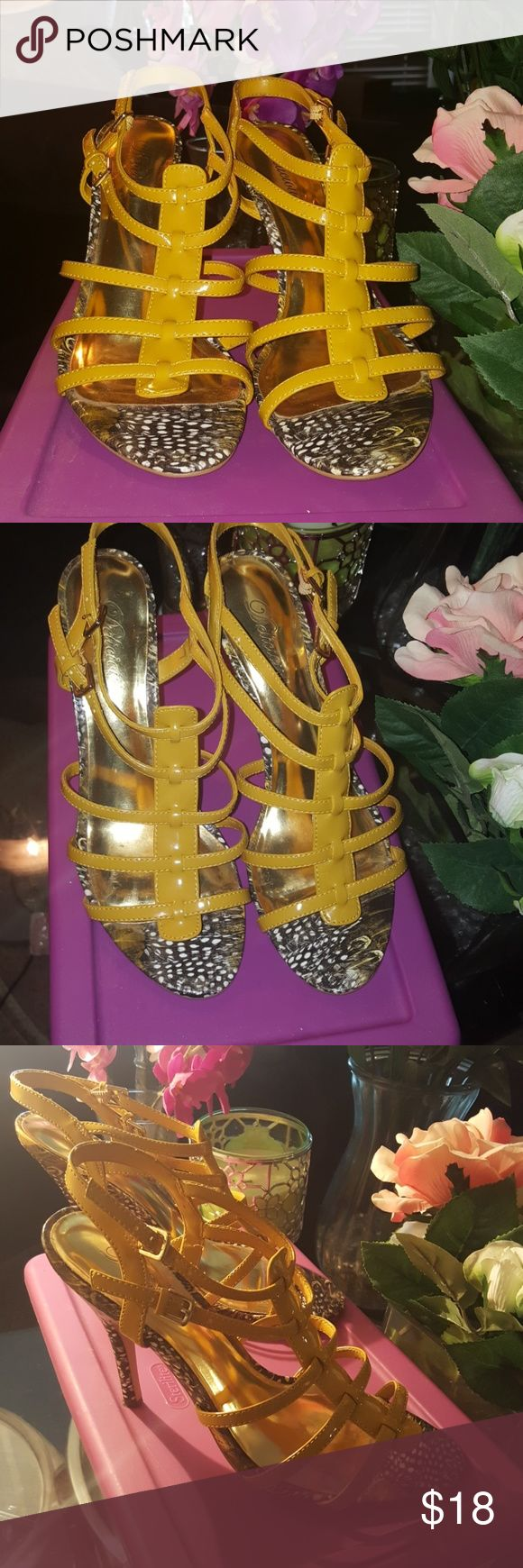 Mustard and animal print heel open toe sandals Gorgeous sandals. Mustard and animal print In great condition  normal wear on bottom of shoes, comes with replacement heels as shown in picture. Size is 8.5| heel height 3.5   | Delicious Shoes Sandals