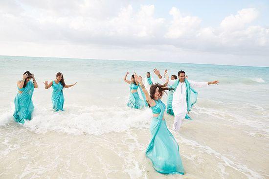 Indian bridesmaids have fun in their aqua dresses and saris at this beach destination wedding
