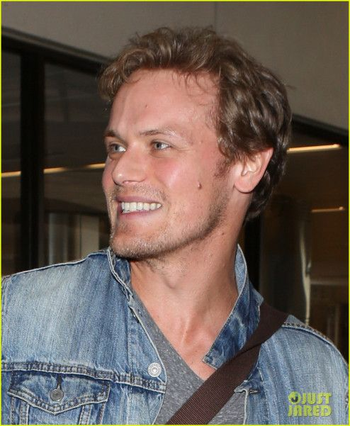 Here are some NEW Pics of Sam Heughan at the airport from Just Jared More after the jump!