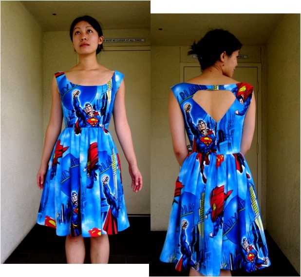 Superman cut out dress made from a bedsheet. Five-dollar sewing project!
