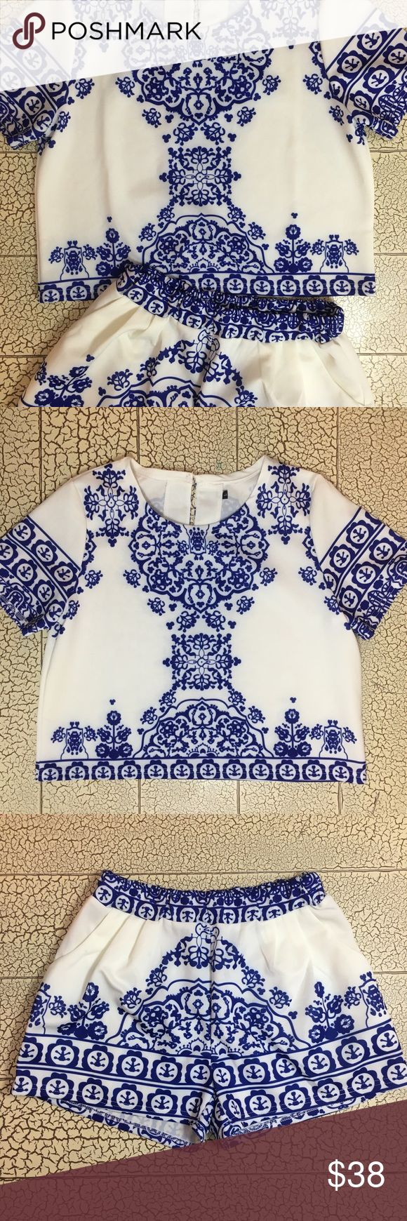 Blue and white crop top/shorts matching set Blue and white porcelain print crop top with matching shorts set! Boho style with a geometric pattern! Never been worn. Size small in both pieces. Material is polyester. Tops Crop Tops
