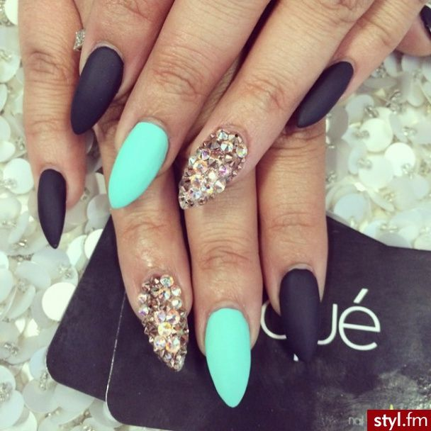 Don't know how I feel about the scary bird like pointy nails but I like the black turquoise and glitter gold