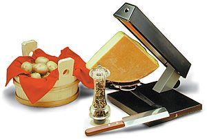 TTM Raclette Cheese Party Melter for 1/4 round of cheese for a traditional raclette dinner. For a group of 6-8. $249.99 www.raclettecorner.com/raclette-melter