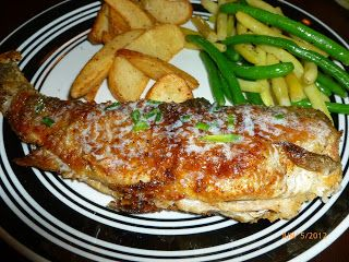 Pan Fried Whole Rainbow Trout with Butter Chive sauce.