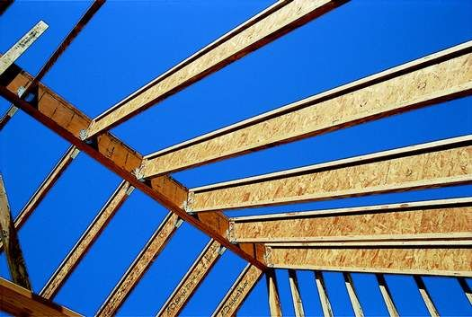 roof rafters, supported in metal hangers, frame into an