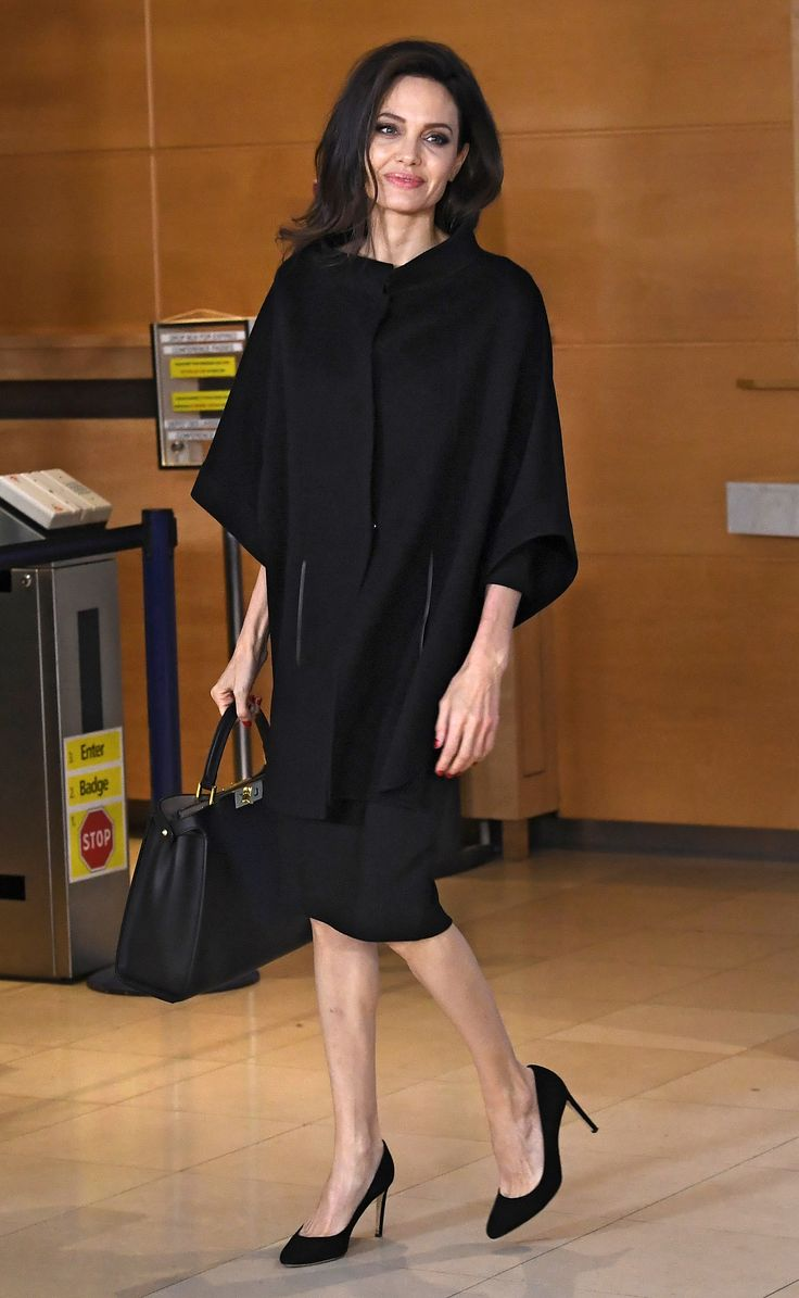 Angelina Jolie Looks Business Chic in Head-to-Toe Blackfor Visit to NATO Headquarters | In her role as co-founder of the Preventing Sexual Violence in Conflict Initiative, Angelina Jolie met withNATO Secretary General Jens Stoltenberg todiscuss ways to prevent sexual violence against women in areas of conflict around the world.