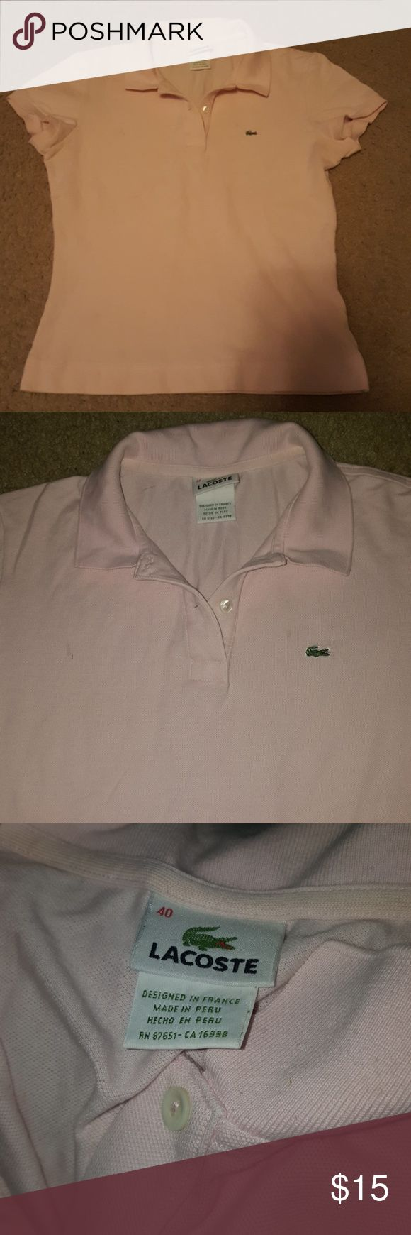 💜Lacoste pink polo junior💜 Lacoste pink polo junior size 40 small. Smoke free home good condition. Lacoste Tops Blouses