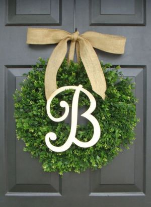 Housewarming Gifts for Newlyweds: Spring Monogram Initial Boxwood Front Door Wreath with Bow by Elegant Wreath @ Etsy
