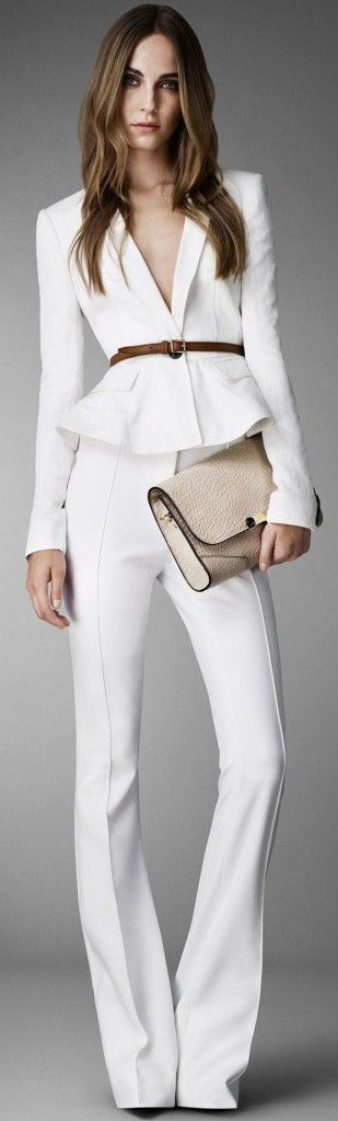 White business suit, white pants, white blazer with braun belt and beige clutch.