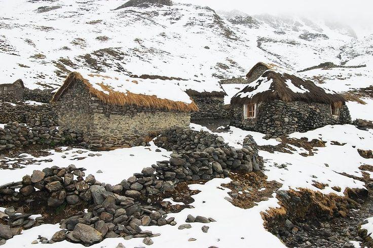 The alpaca herding village of the Q'eros people under snow, Cordillera de Paucartambo, Peru   Ethan Welty
