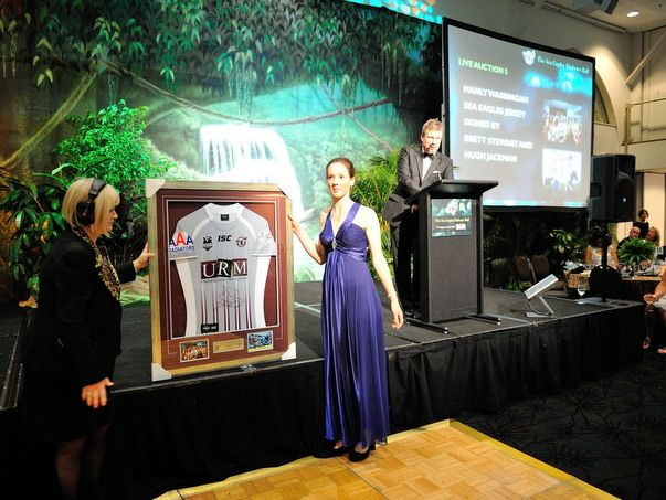Ezybidz's framed this spectacular Hugh Jackman and Brett Stewart signed jersey pictured here being auctioned at the Sea Eagles' Diabetes Ball 2013