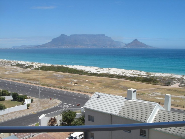 The view from my appartment, Capetowns Table Mountain and lionshead. Beach in front is great for kitesurfing :)