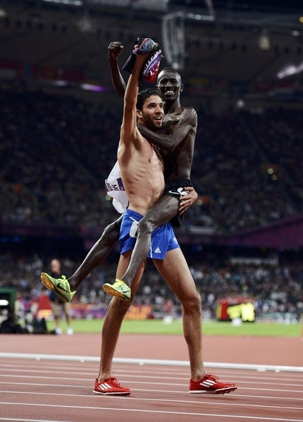 France's Mahiedine Mekhissi-Benabbad, who won silver, carries gold medallist Kenya's Ezekiel Kemboi as they celebrate after the men's 3000m steeplechase final during the London 2012 Olympic Games at the Olympic Stadium August 5, 2012.  (via mediterraneenne)