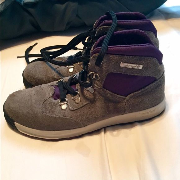 Timberland boots Girls 5.5 youth Timberland boots. Equivalent to a 7.5 woman's. Grey and purple and worn only a couple times. Hole on right inner boot. Literally no other damage or wear. Timberland Shoes Lace Up Boots