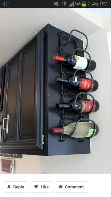 Wine rack at the end of the cabinets