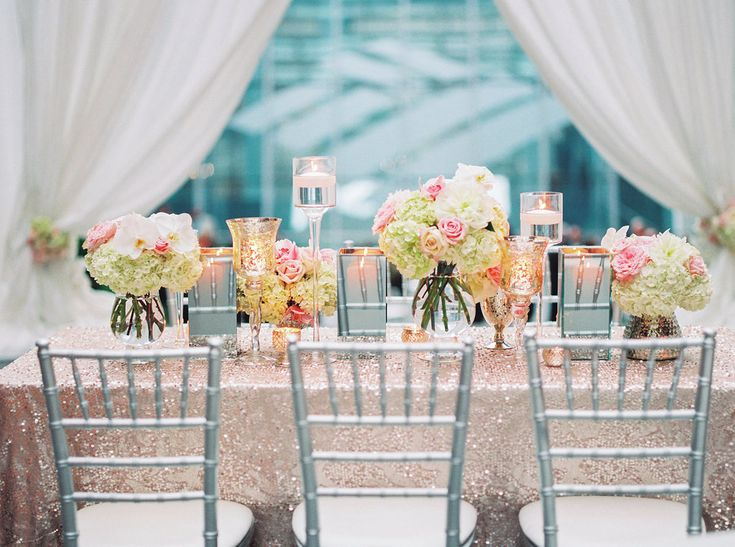 Reception Table with Sequin Blush Linen  Photography: Lauren Rosenau Photography Read More: http://www.insideweddings.com/weddings/sweet-wedding-with-soft-blush-and-silver-palette-in-north-carolina/831/