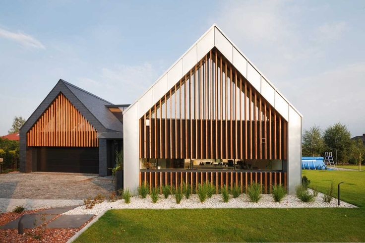 Two Barns House by RS+ Architects located in Tychy, Poland