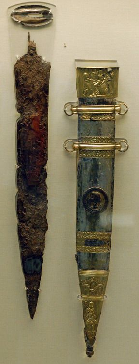 The Sword of Tiberius, a Roman Gladius and scabbard. Iron, Gold, Bronze, Tin. ca 15 CE Rhineland Palatinate. Depicts Tiberius presenting Augustus with military victory.