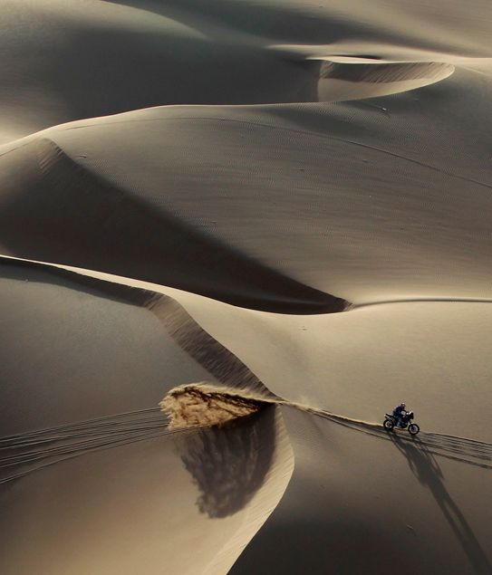 A competitor rides in the dunes during the sixth stage of the Dakar Rally 2011 from Iquique to Arica January 7, 2011. (REUTERS/Eric Gaillard) http://www.boston.com/bigpicture/2011/01/dakar_2011.html