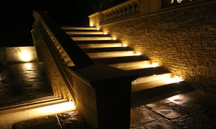 Step Lighting. For these large steps, Moonlight Design supplied and installed Hunza solid eyelid step lights in copper. This project was in Gloucestershire.