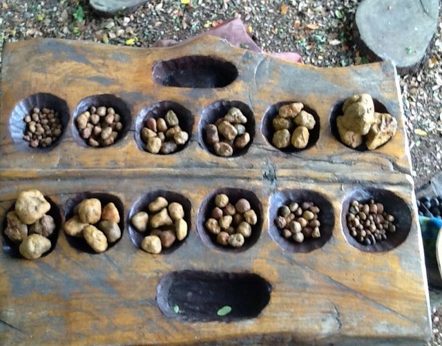Mancala (oware) board comes in handy for early childhood loose parts play with graded stones.