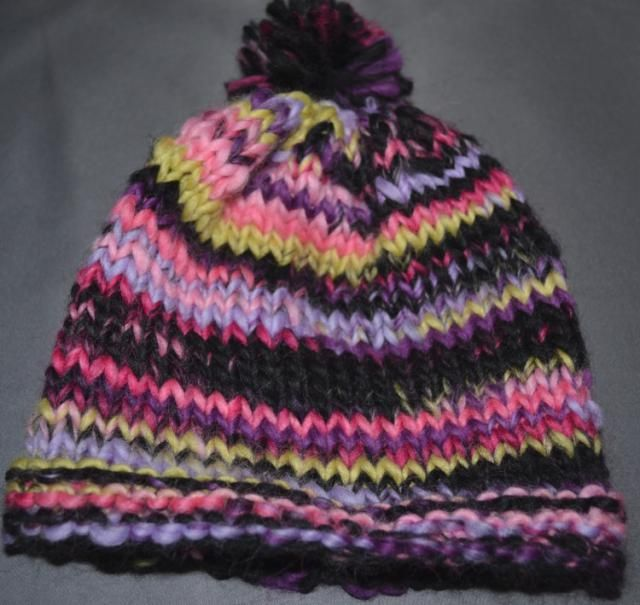 This flat hat is a super simple and cute way to welcome a new baby (up to a year) and use up a fun yarn in your stash at the same time. This is a great first hat project, and would make a good second or third knitting project.