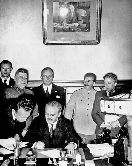 Vyacheslav Molotov signs the Molotov-Ribbentrop Pact, a German-Sovietnon-aggression pact.
