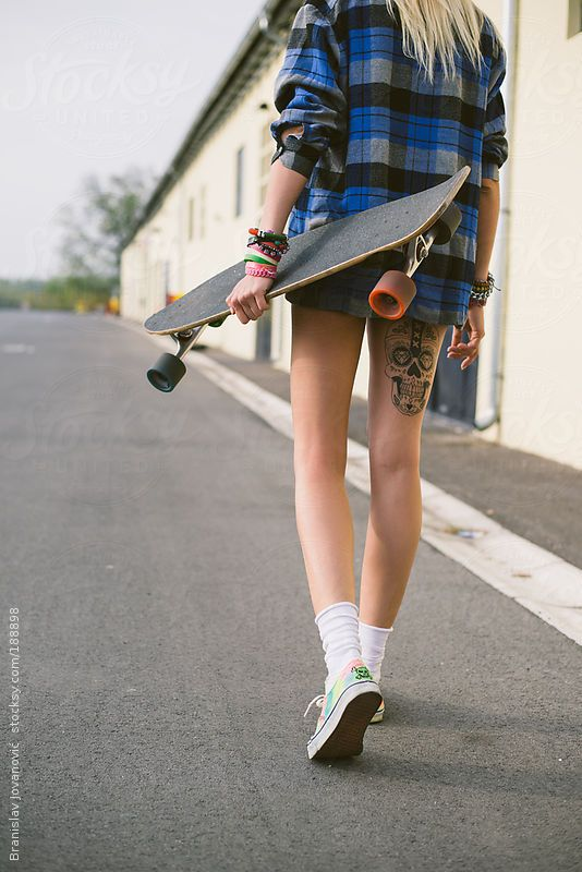 Urban woman with longboard by Branislav Jovanović