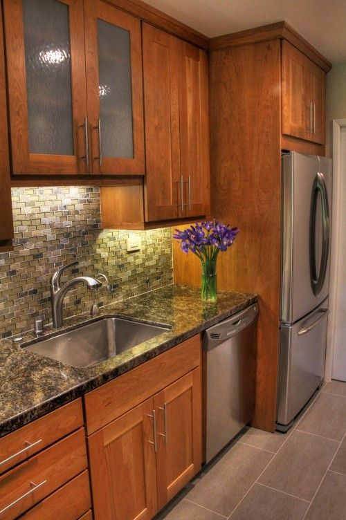 Mix of wood and frosted glass cabinets