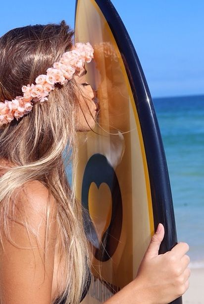 Awesome!!! @marcoandre01 :) Girl with Lei kissing surfboard | re-pinned by http://about.me/southfloridah2o