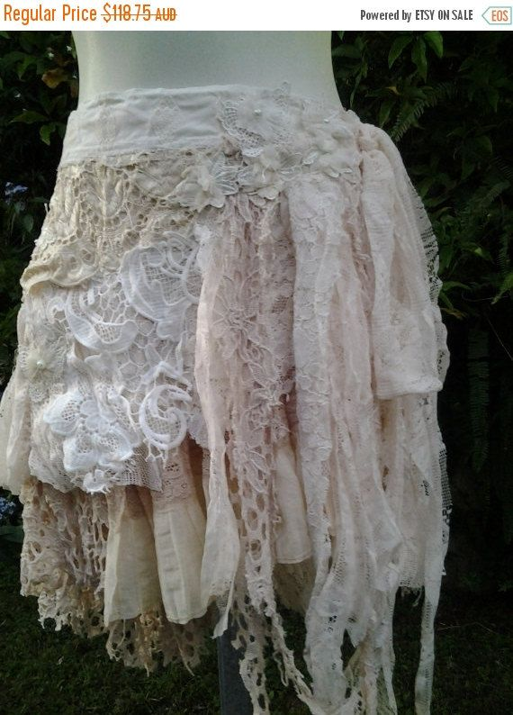shes a gorgeous bohemian wrap around vintage inspired skirt kissed with assorted crochets,laces and embroidered netting in hues of ivory with shabby