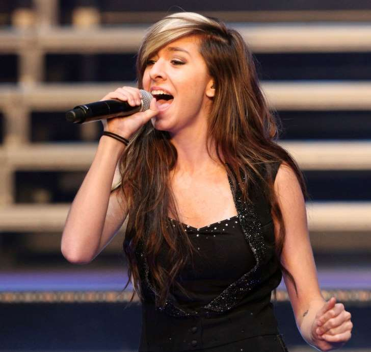 "FILE - In this June 29, 2014 file photo, ""The Voice"" Season 6 contestant Christina Grimmie performs as part of ""The Voice Tour"" at Cobb Energy Centre, in Atlanta. An attorney for the family of singer Christina Grimmie says he will refile an amended wrongful death lawsuit against the promoter and venue where ""The Voice"" contestant was fatally shot. Attorney Brian Caplan said Tuesday, May 23, 2017, that Grimmie's family will file a new complaint after a Florida judge dismissed the original…"