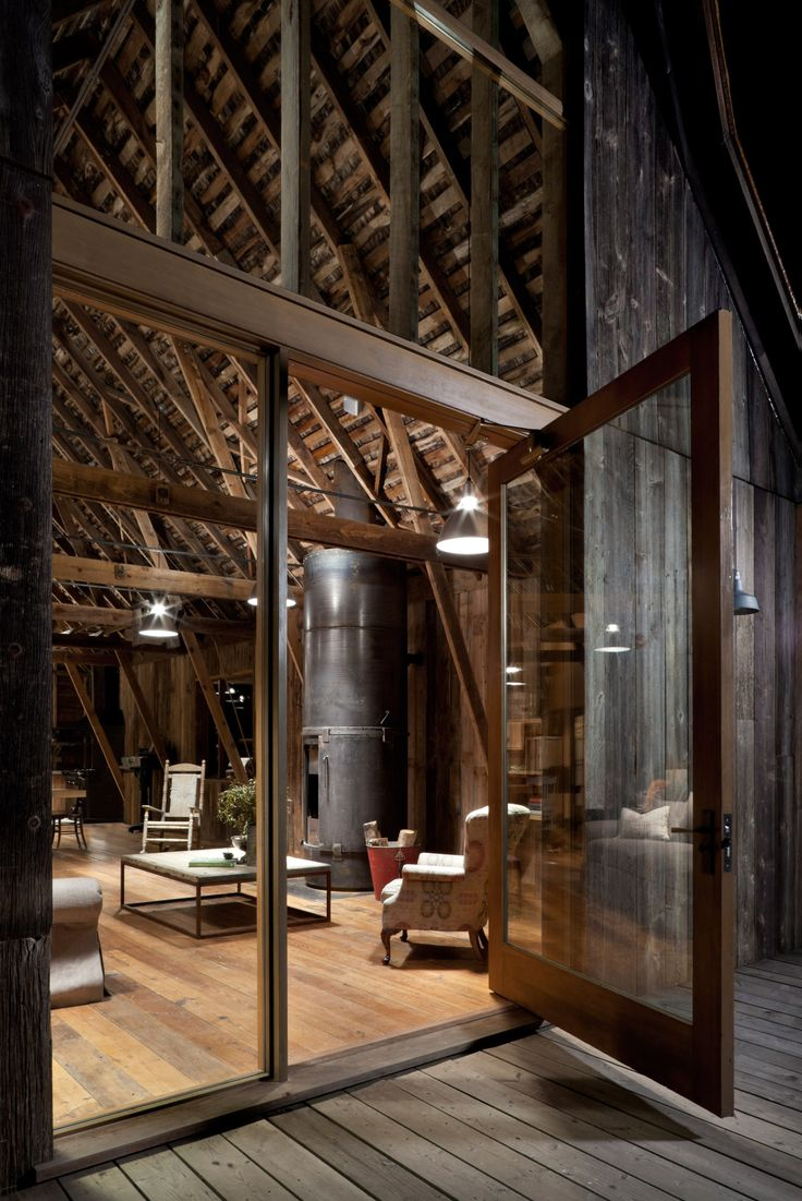 archatlas: Canyon Barn in Washington In the words of the architects MW Works: Located in the eastern foothills of the cascades, this renovation converted a turn of the century working barn into a three-bedroom retreat from the city. The building was restored with the intention of creating a comfortable home while retaining much of its original form, character and history. Siding, paneling, flooring, even fixtures and doors were sourced from either the original building or salvage yar...