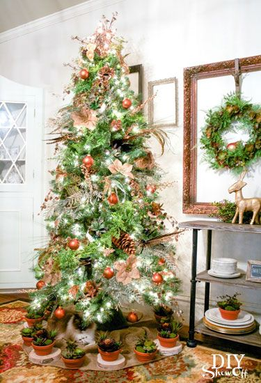 Aside from the grapevine orbs and burlap poinsettias, what we love most about this tree are the potted succulents that circle the tree skirt.