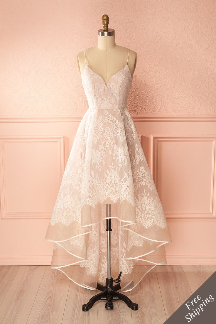 Verena #Boutique1861 / You'll be a breath of fresh air in this beautiful and elegant lace dress. The asymmetrical skirt falls gracefully to the floor and flows about you. The fitted bodice will stay in place thanks to its integrated cups and boning. Take advantage of its cut by wearing your prettiest pair of heels!