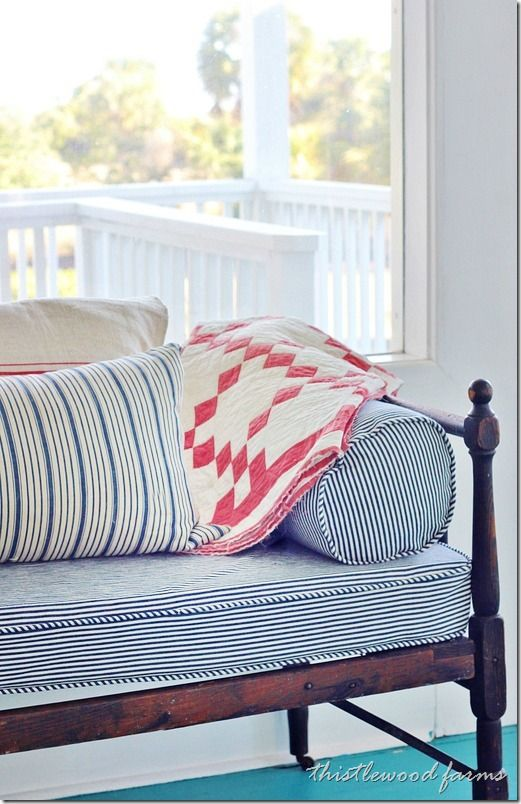 love the daybed with upholstered mattress, side bolsters, tons of pillows and cozy quilt - so appealing!