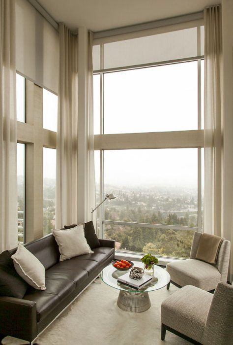Bright sunlight is a not a problem for these floor to ceiling living room windows in the Berkeley hills with custom motorized window shades that cut glare and heat. Extra long over-sized curtains soften the modern edge.