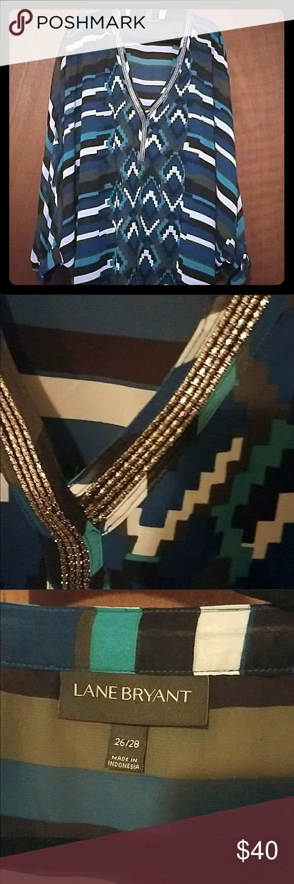 Lane Bryant Aztec Sheer Top W/Batwing sleeves NWOT NWOT -Beautiful turquoise, dark blue and black with white accents and silver embellishments Aztec print batwing top. Sleeves are cuffed landing right at the elbow. Best option may be to wear a camisole or tank underneath. Please see last picture for an idea of how this top will fit. 26/28 Lane Bryant Tops Blouses