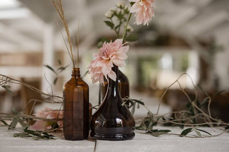 Prop styling, wedding table decor, wedding flowers in antique brown bottles