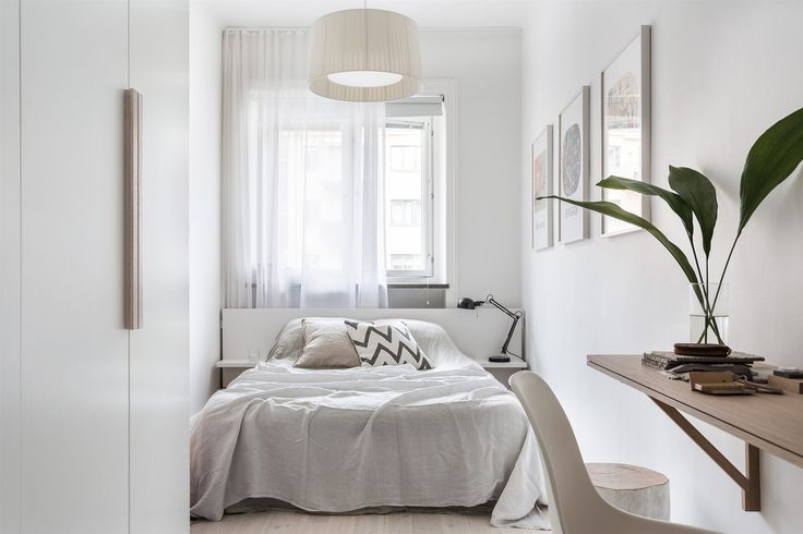 white bedroom with wall mounted shelf as a desk