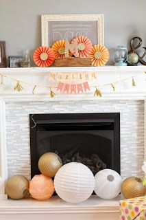 Peach & gold: love the personalized bunting, globes, and pinwheels.