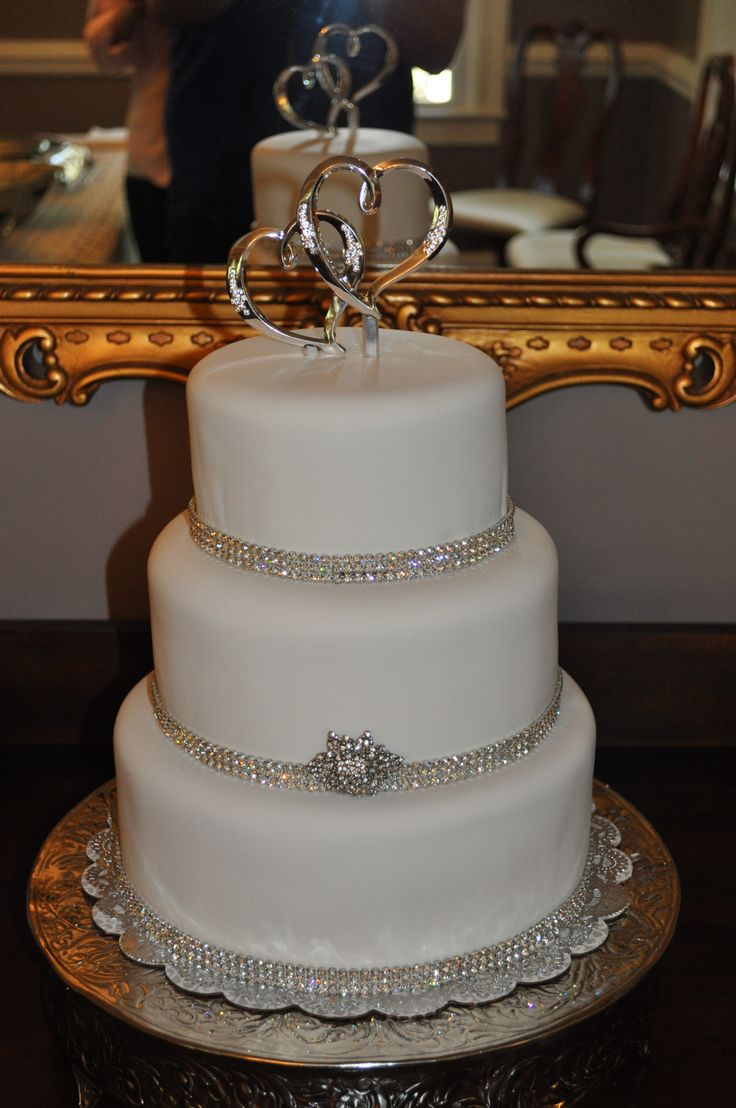 Bling Wedding Cake - Three tier 10, 8, 6 red velvet cake with cream cheese filling, covered in Satin Ice fondant.  Wrapped each base with rhinestone trim and the brooche and topper were supplied by the bride.  Thanks for the ideas to fellow CCers!! TFL