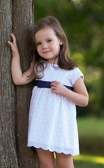 White eyelet flower girl dress with navy stripe. Baby CZ by Carolina Zapf.
